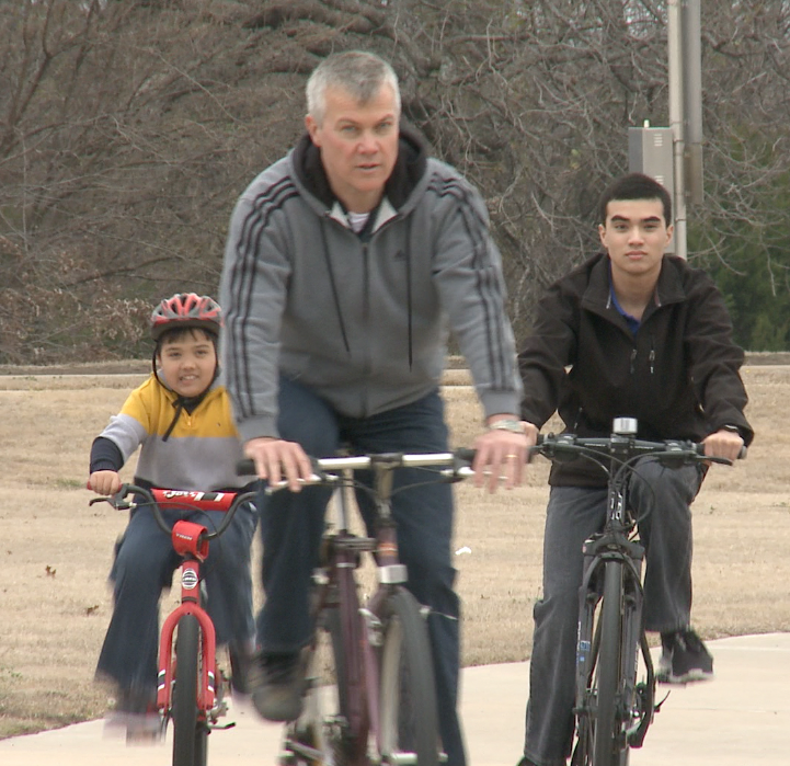 From left: Jude, Keith and Joshua Cobler on a recent bike ride in Plano. Photo/Mark Birnbaum
