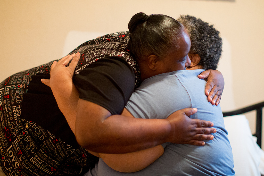 Cynthia Pullen, house manager and care giver for a group home in Glenn Heights, Texas, hugs new client Felicia Rush. Cynthia Pullen, house manager and caregiver for a group home in Glenn Heights, Texas, hugs new client Felicia Rush. Felicia Rush, 52, says she enjoys living with other people in her Glen Heights, Texas, group home versus living alone in her old garage apartment in Beaumont. (Photo/Allison V. Smith)