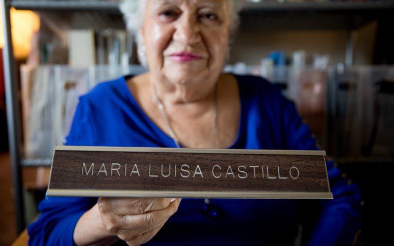 Maria Luisa Castillo Rocha holding a nameplate