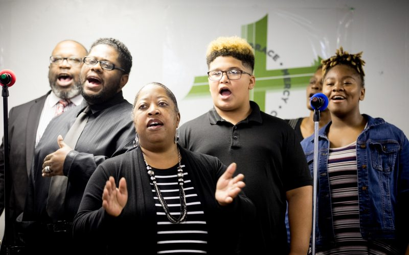 Debbie Spruell sings with other members