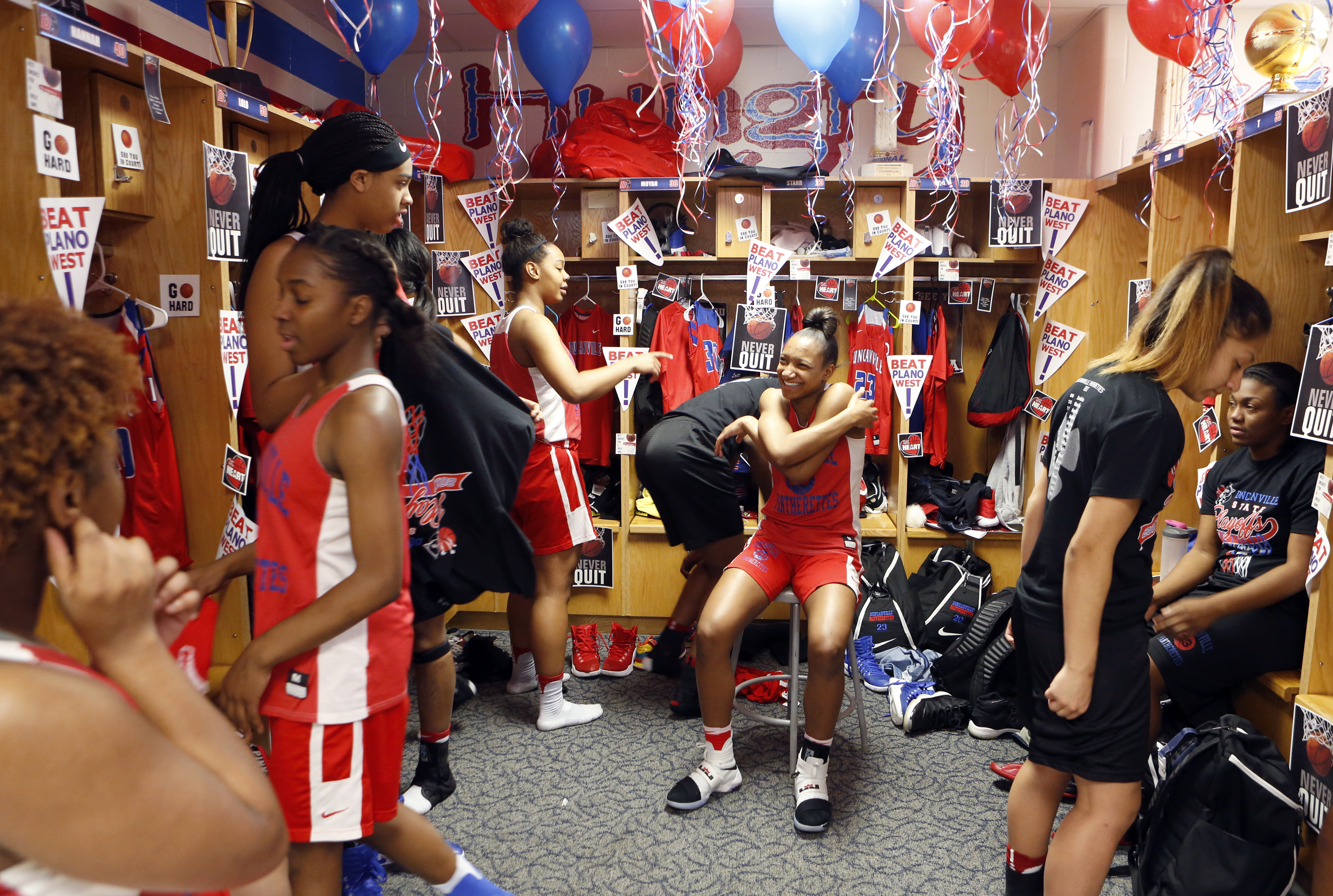 Junior Guard Aniya Thomas (center) and other Duncanville Pantherettes in the locker room after practice at Duncanville High School. Photographed in Duncanville, Texas on Friday, February 17, 2017. (photo © Lara Solt)