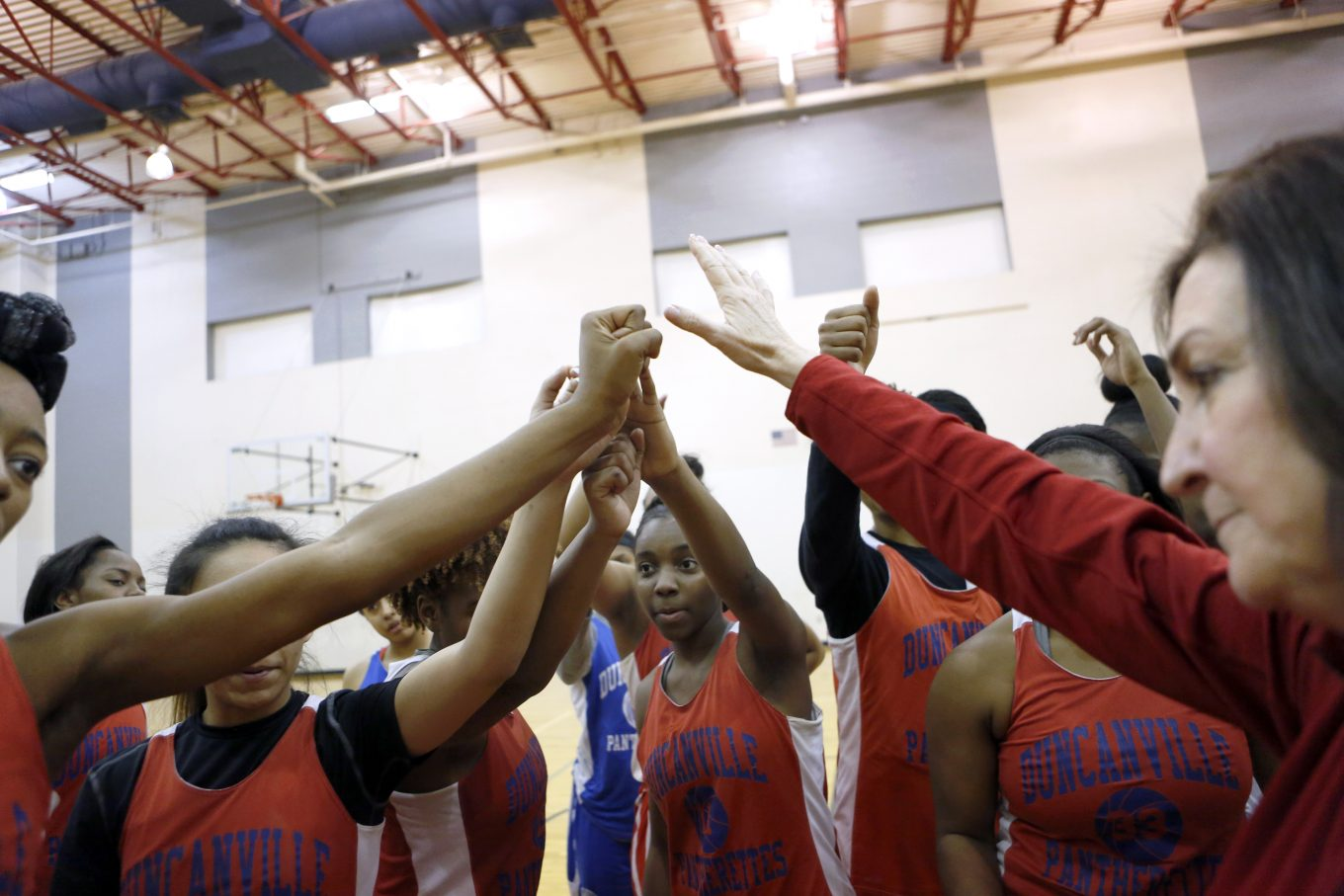 Head coach Cathy Self-Morgan gives her team high-fives after practice at Duncanville High School. Photo/Lara Solt
