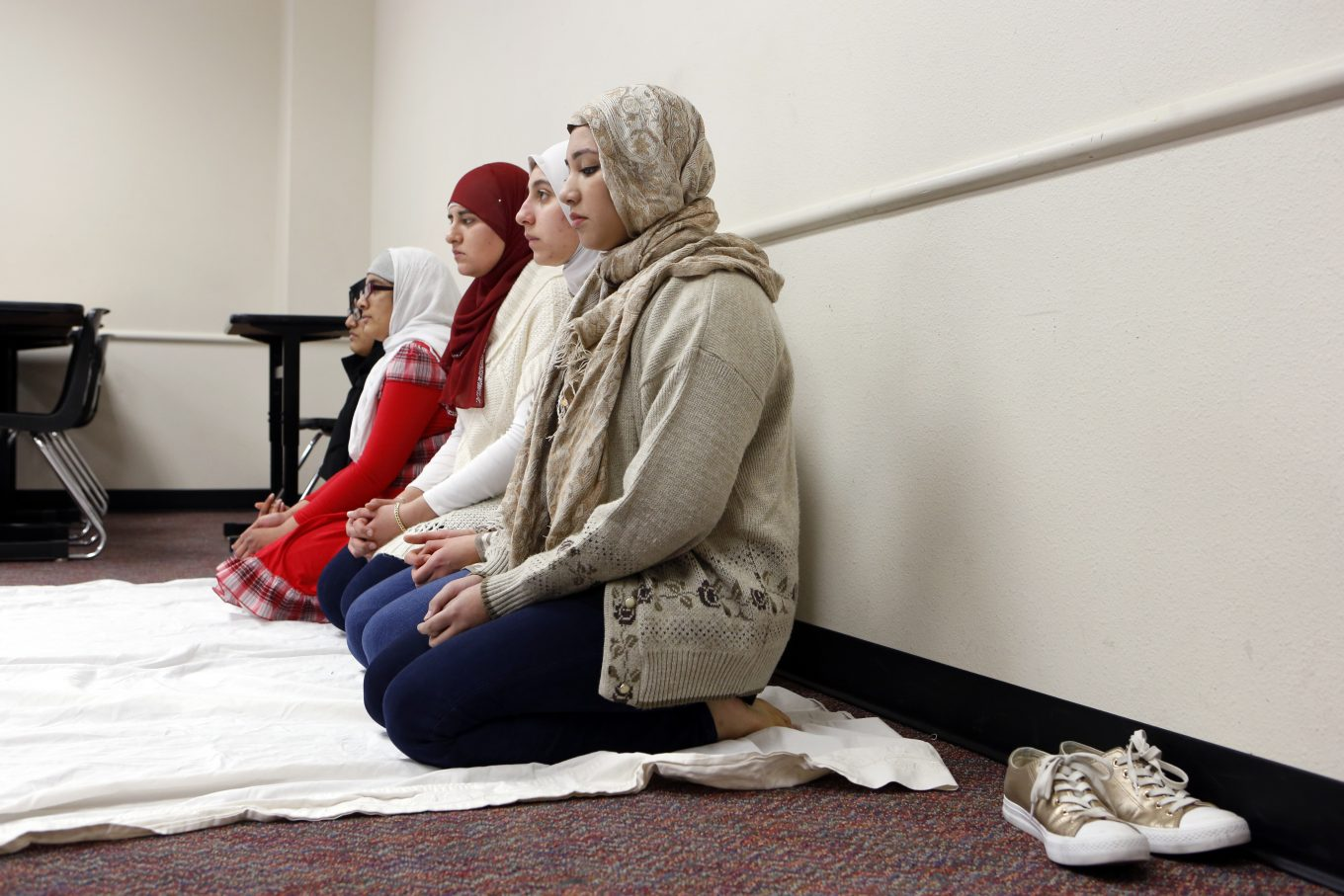 Amna Salman (foreground) and other Muslim students gather to pray inside a classroom at Liberty High in Frisco. Photo/Lara Solt