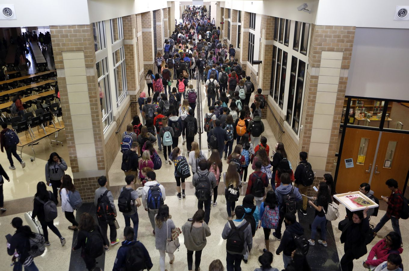 Students crowd the hallway after the last bell rings at Liberty High School in Frisco. Photo/Lara Solt