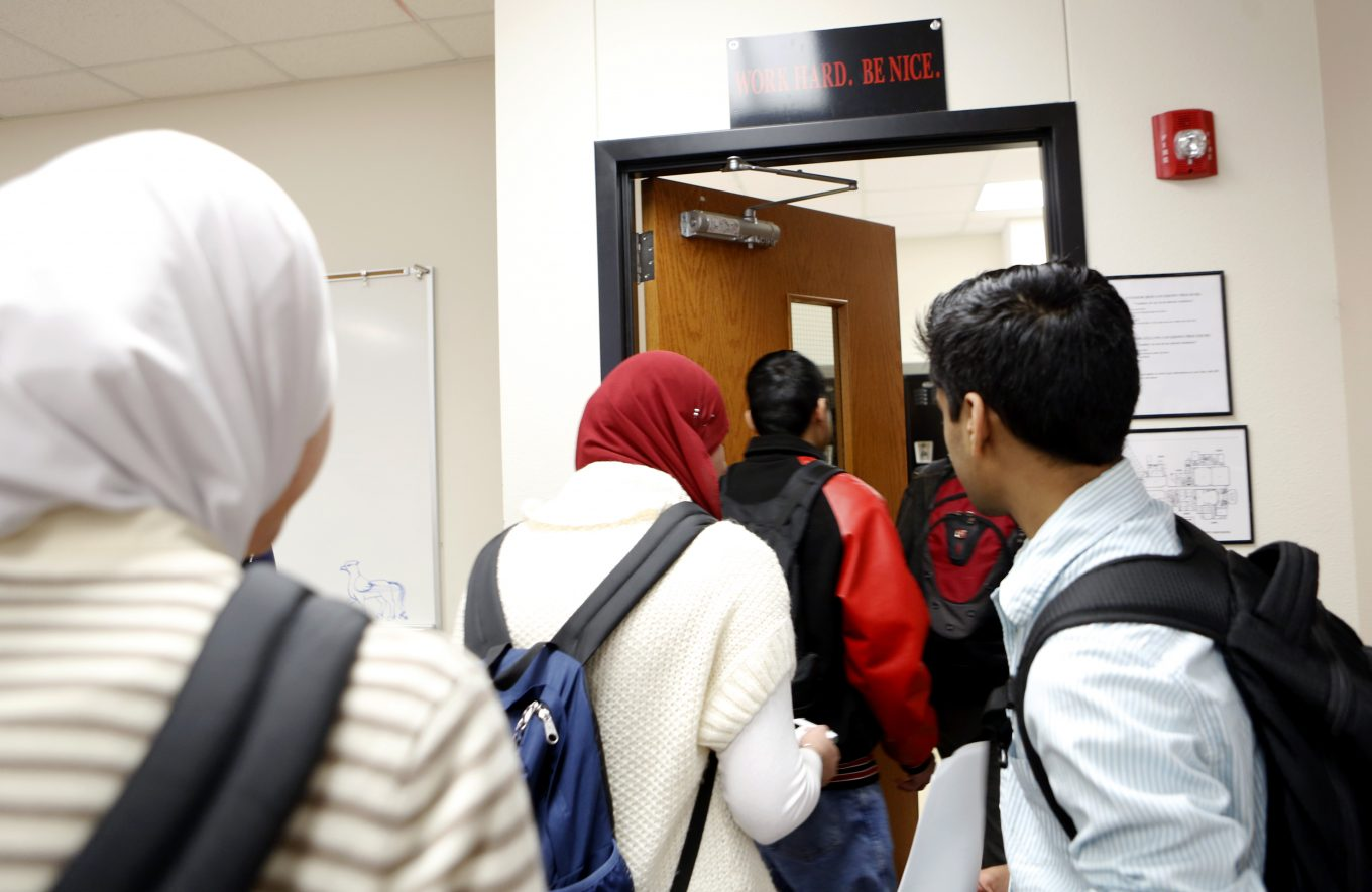 Muslim students return to class after gathering together for prayer at Liberty High School. Photo/Lara Solt