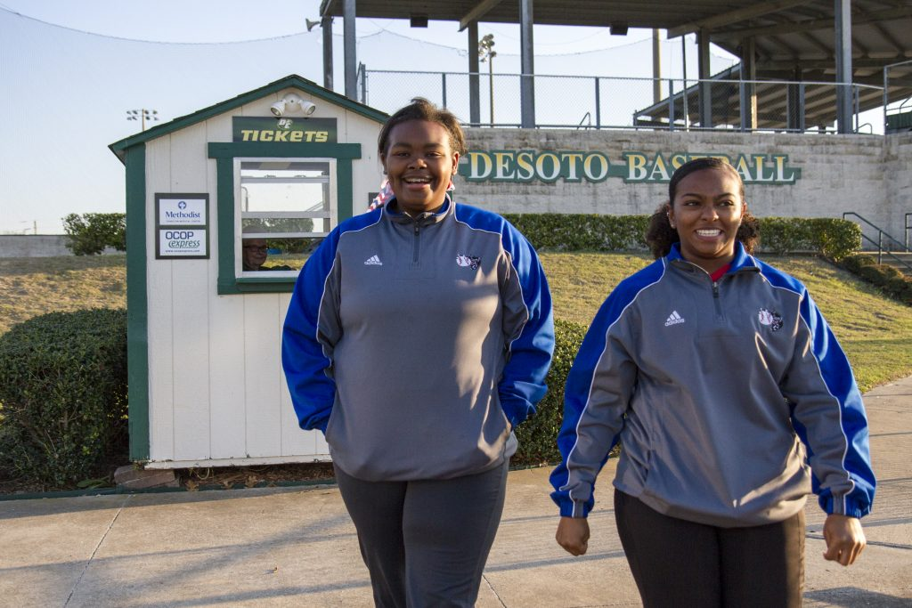 "Rykevia ""Rocky"" Branch and team trainer Maira Martinez walk into Desoto's baseball field."