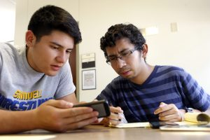 Joel Luera (right), and Steve Vasquez (left) study for a biology test at Eastfield College Campus. Photo/Lara Solt