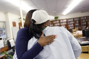 Program of Choice Coordinator Javetta Jones-Roberson, (left) gives Kelli Bowdy a hug after talking with her at O. D. Wyatt High School in Fort Worth, Texas. Photographed Monday, April 25, 2016. (photo © Lara Solt)