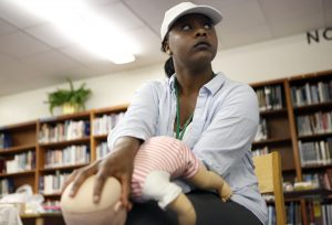 Kelli Bowdy practices infant choking rescue on a mannequin in the Nursing Assistance Program as part of the Health Science and Technology Program of Choice at O. D. Wyatt High School in Fort Worth, Texas. Photographed Monday, April 25, 2016. (photo © Lara Solt)