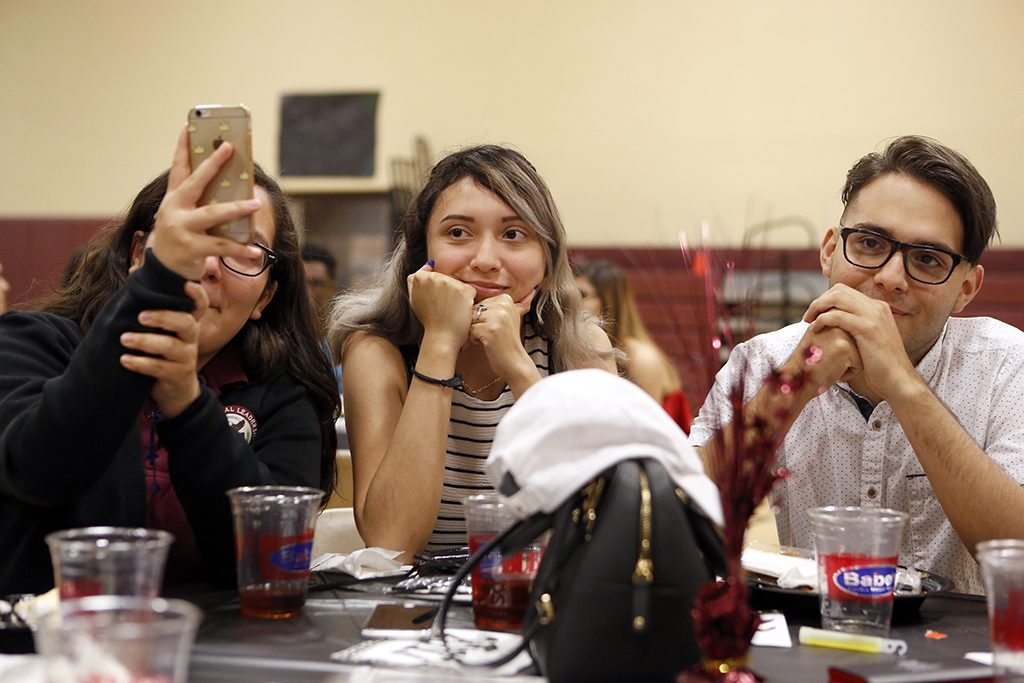 Alexandria Gutierrez (center), Anthony Banuelos (right) and Rebecca Banuelos (left) listen while Anthony's mother, Norma Banuelos, speaks about him during the senior banquet at International Leadership of Texas in Garland on Wednesday, May 25, 2017. (photo © Lara Solt)