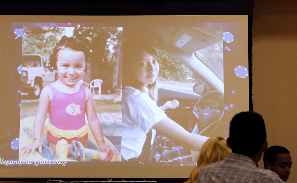 A slideshow displays photos of seniors, including pictures of Alexandria Gutierrez, during the senior banquet at International Leadership of Texas in Garland on Wednesday, May 25, 2017. (photo © Lara Solt)