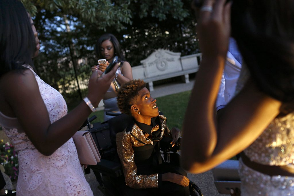 Chance Hawkins (center) is surrounded by friends at the Dunbar High School prom in Arlington, Texas on Saturday, May 6, 2017. (photo © Lara Solt)