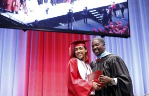 Phantasia Chavers poses with her diploma while walking the stage during her graduation from Cedar Hill High School at College Park Center in Arlington on Friday, May 26, 2017. (photo © Lara Solt)