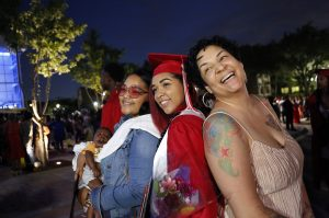 Phantasia Chavers (center) poses for photos with her mother, Jameka Chavers, (right) and sister, Jaquaylla Williams, while celebrating her graduation from Cedar Hill High School at College Park Center in Arlington on Friday, May 26, 2017. (photo © Lara Solt)