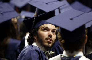 Ricky Rijos Jr. turns to look for his family and friends during his graduation from Flower Mound High School at UNT Coliseum in Denton, on Monday, June 6, 2017. (photo © Lara Solt)