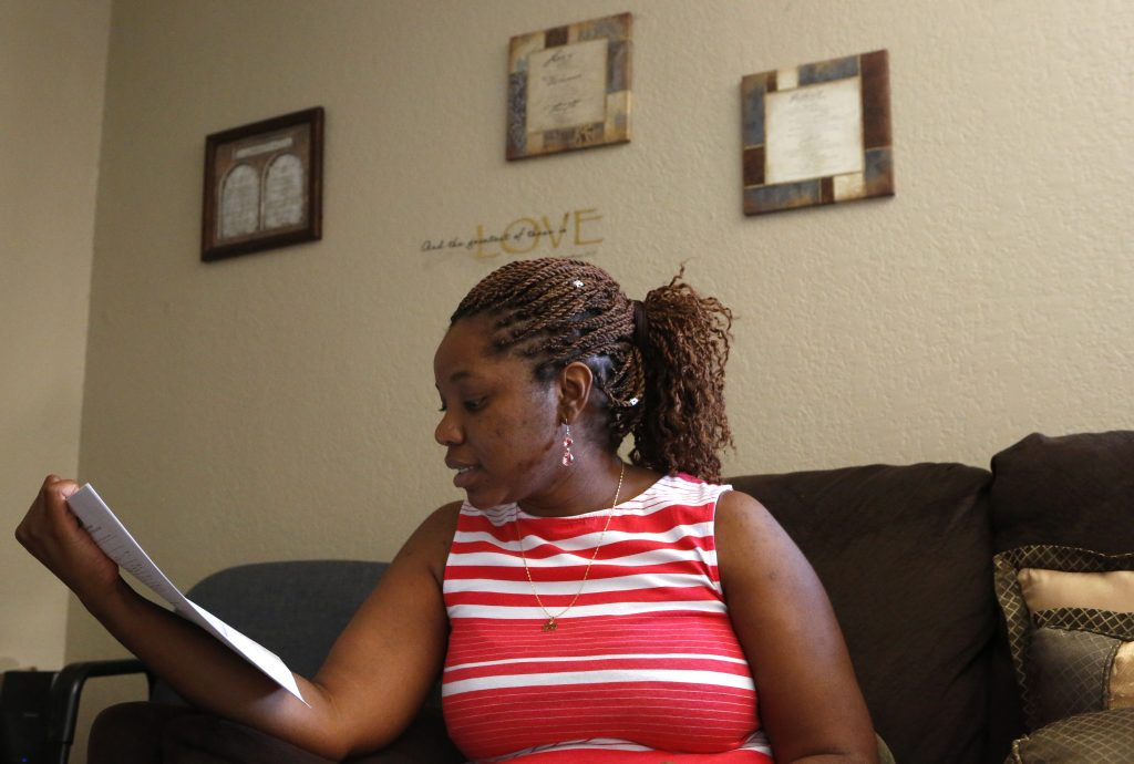 April Ford looks over papers in preparation for the new school year at her home in North Richland Hills, Texas on Thursday, August 11, 2016. (photo © Lara Solt)