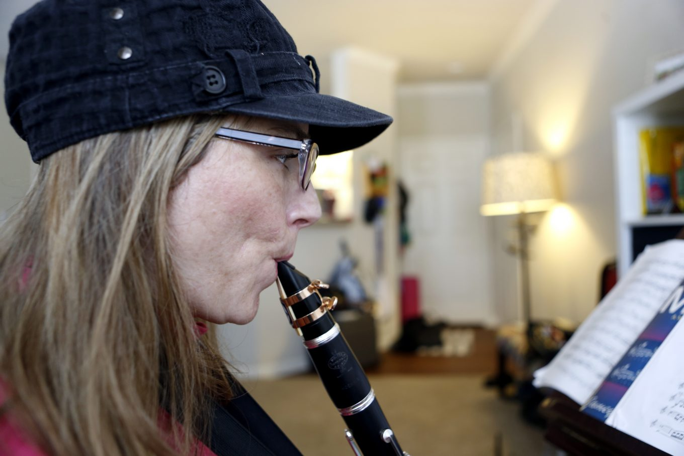 Katie Combest plays her clarinet at her home in Lewisville. Photo/Lara Solt