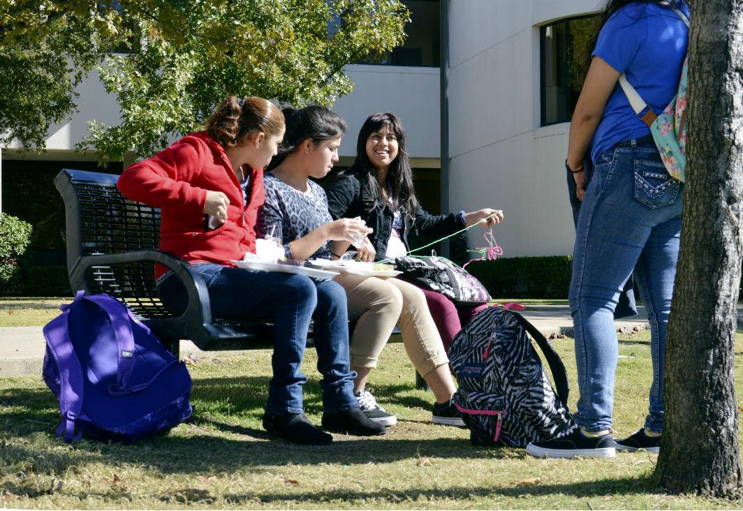 Dilcia Mazariegos takes a break with friends outside Plano East Senior High. Photo/Christina Ulsh