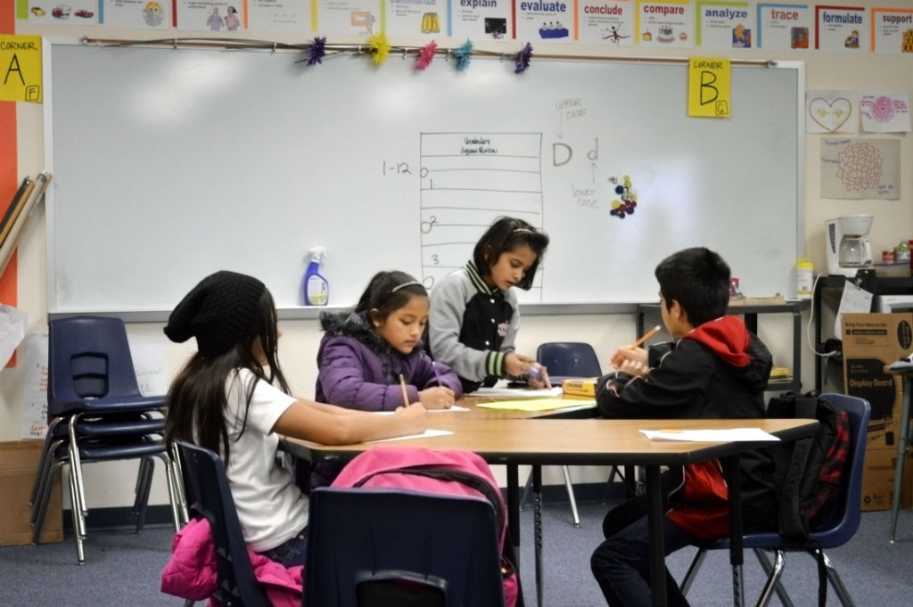 From left, Devanhy Lopez Fragoso and other students work on a social studies jigsaw vocabulary review at International Newcomer Academy in Fort Worth ISD. Photo/Christina Ulsh