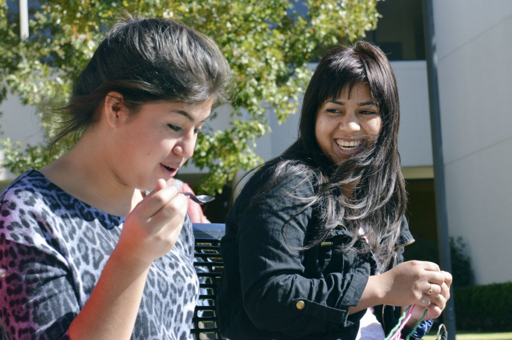 Dilcia Mazariegos, right,  hangs out with a friend outside Plano East Senior High. Photo/Christina Ulsh