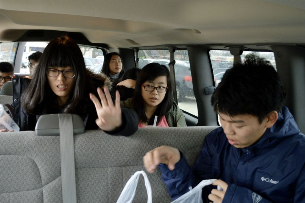 Students from International Leadership of Texas pile into a school van after going grocery shopping at a Chinese store in Plano. Photo/Christina Ulsh