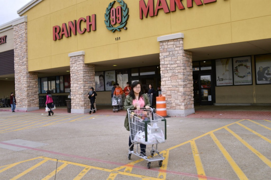Arron leaves Ranch 99 Market in Plano with a bunch of goodies that remind her of China. Photo/Christina Ulsh
