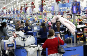 Cashier Kamilla Fletcher helps customers in the checkout line at Walmart in Dallas. Photographed on Monday, November 16, 2015. Photo/Lara Solt