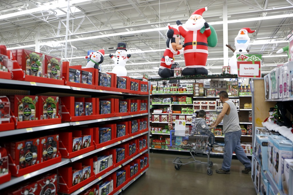 Shoppers walk through Christmas aisles at Walmart in Dallas. Photographed on Monday, November 16, 2015. Photo/Lara Solt