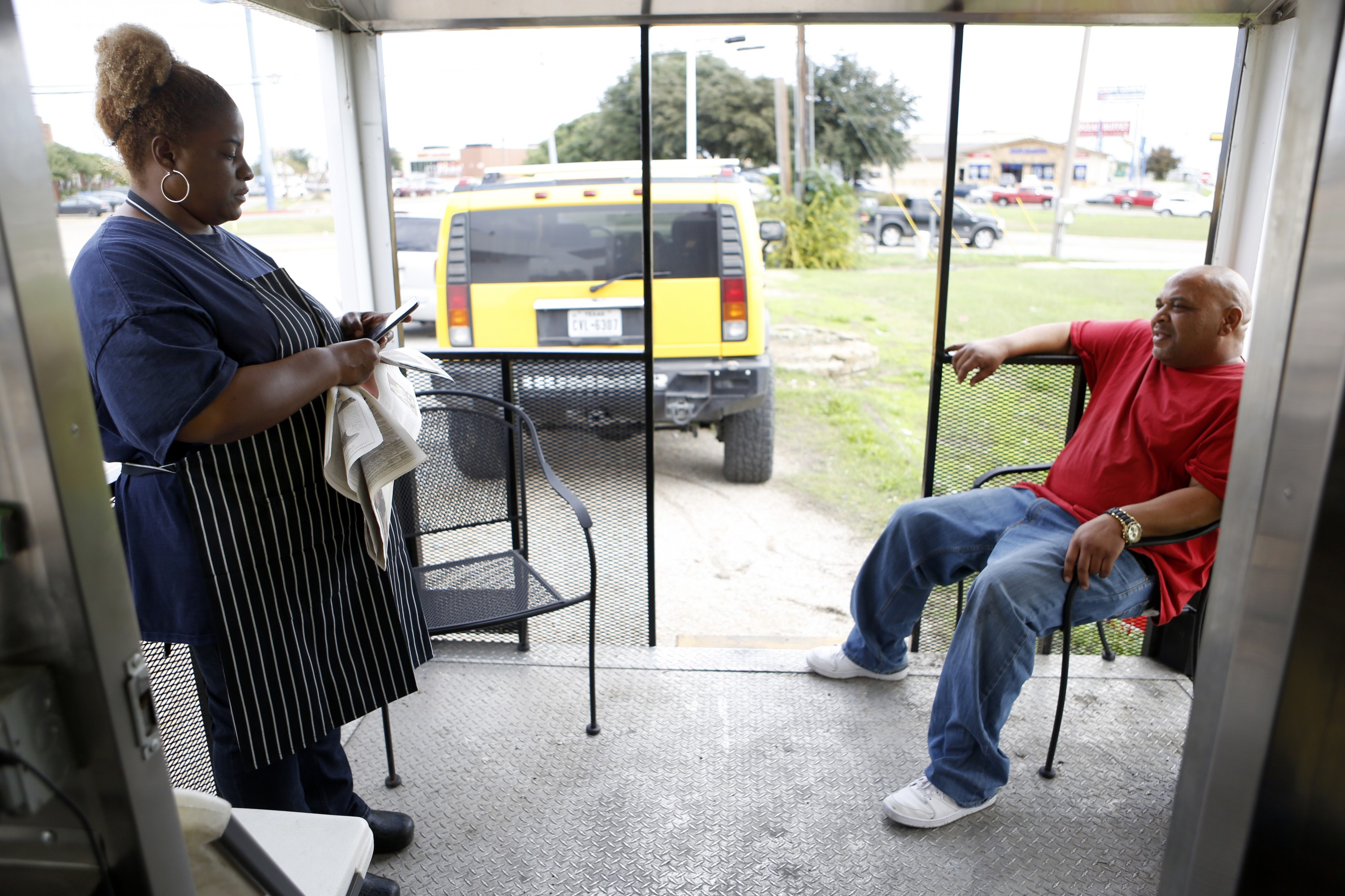 Quincy and Sheri Brown at their food truck, Ain't No Mo! Butter Cakes, on their third day operating from a Shell gas station near Interstate 635 and Ferguson Road in Garland. Photo/Lara Solt