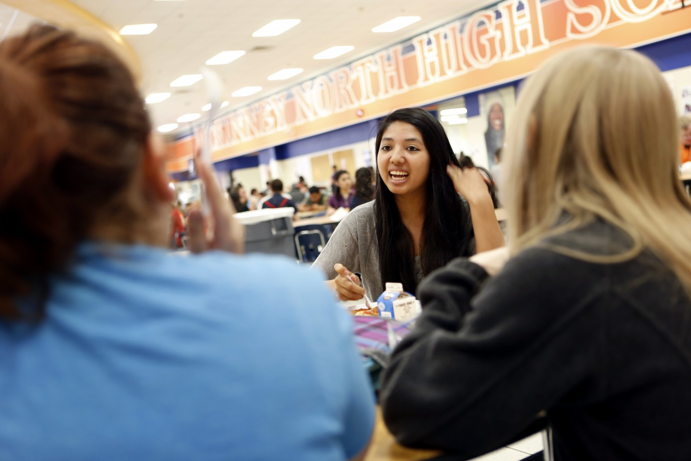 Sylvia Torres eats lunch at McKinney North High School. Photo/Lara Solt