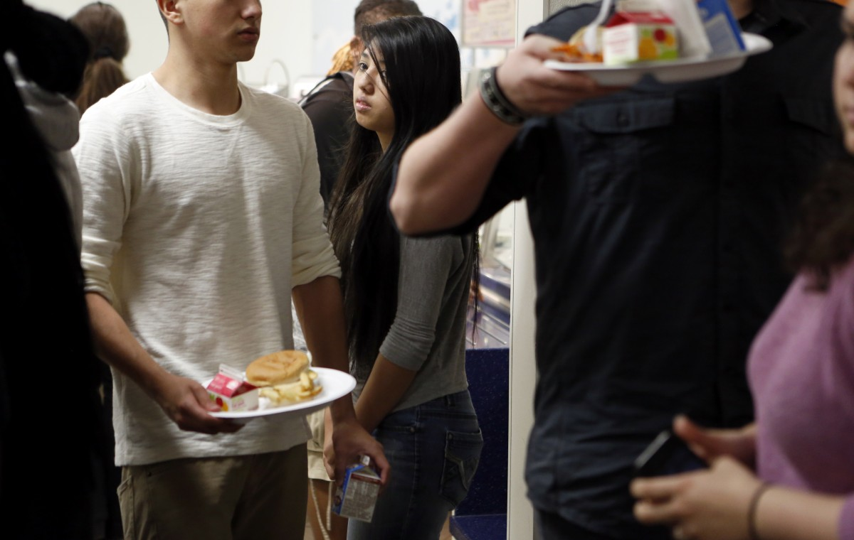 Sylvia Torres waits for lunch in the cafeteria at McKinney North High School. Photo/Lara Solt