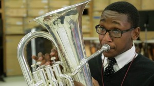 Desmond Davis plays in the band at North Dallas High School. Photo/Ginny Martin