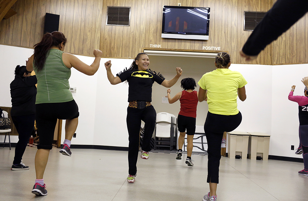 Maribel Del Campo, center, leads a Zumba class held in The Old Church at Jubilee Park across from Jubilee Park Community Center. Photo/Lara Solt
