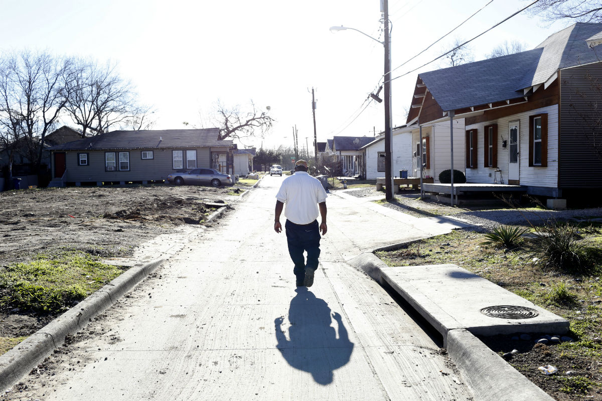 Quincy Williams walks down the street toward Carroll Avenue. Photo/Lara Solt