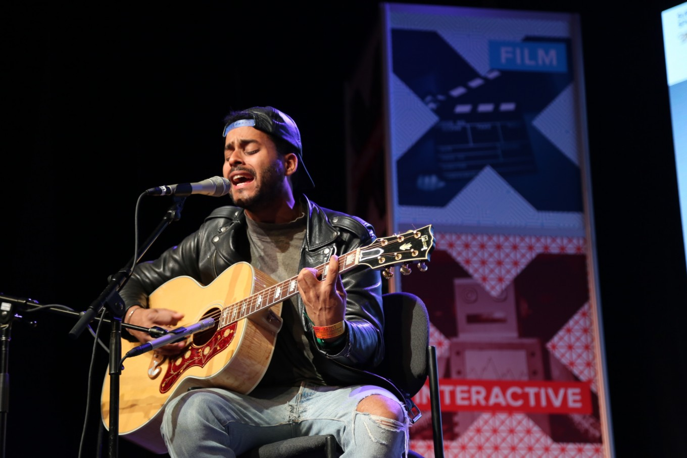 Twin Shadow performs first at the Public Radio Day Stage.
