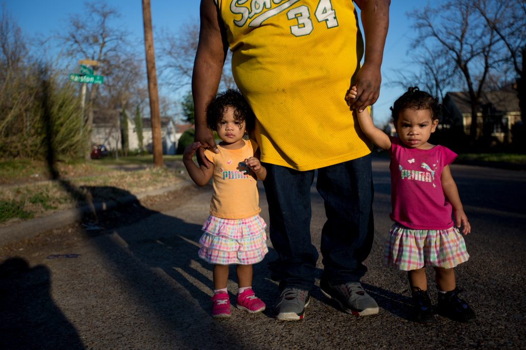 Tony Mims and his twin daughters in West Dallas