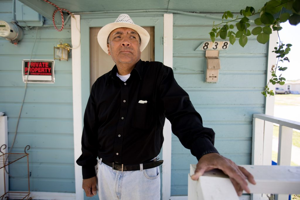 Joe Garcia on the front porch of his home where he lives with his 84-year-old mother on McBroom Street in West Dallas. Photo/Allison V. Smith