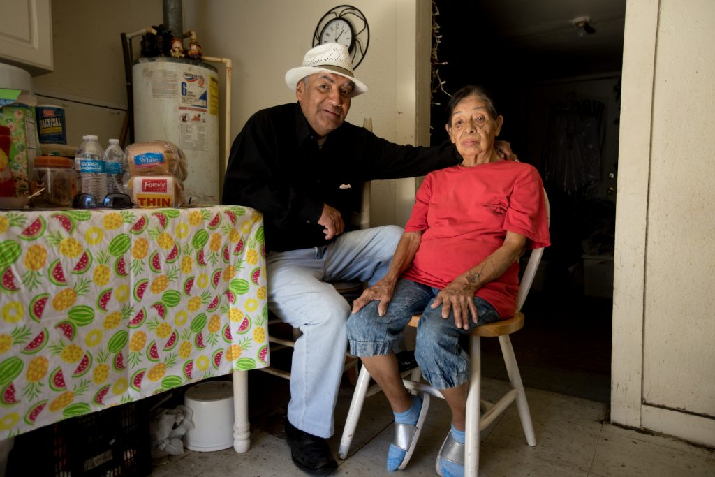 Joe Garcia and his 84-year-old mother, Lily, in their kitchen on McBroom Street in West Dallas. Photo/Allison V. Smith