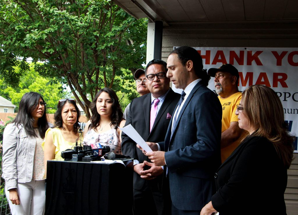 Khraish Khraish, third from right, announced Monday morning he's offering to sell several of his rental homes to tenants in West Dallas. Photo/Jessica Diaz-Hurtado