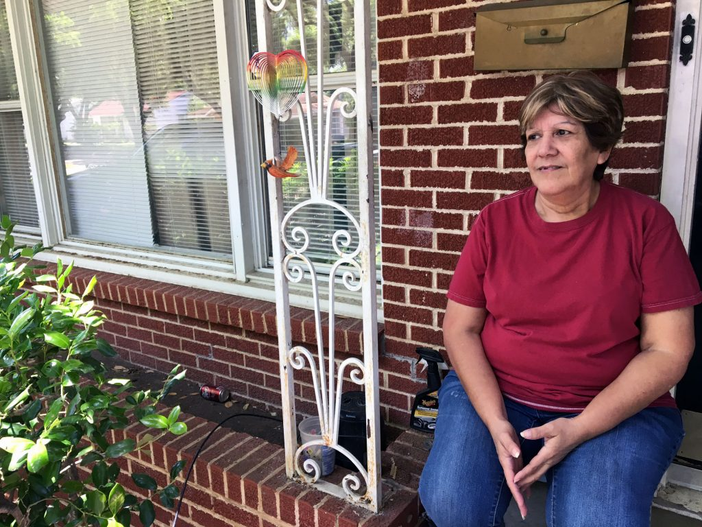 Rosemary Guerra sits on the porch of her home in Oak Cliff. She moved from her West Dallas home in November, soon after HMK Ltd.'s initial eviction notice. Photo/Courtney Collins