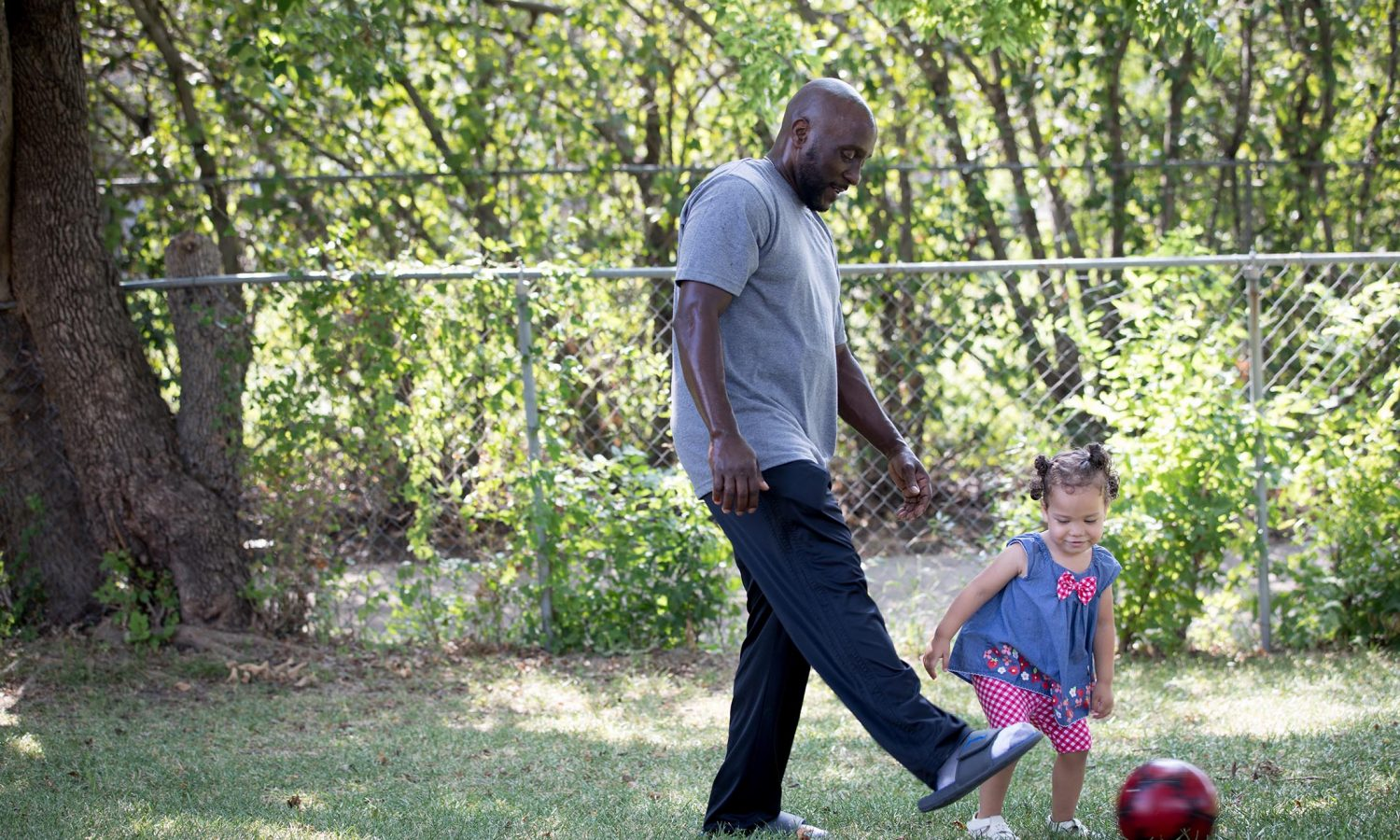Marc Wilson plays with his granddaughter. Part of the One Crisis Away: Price of Prison series.