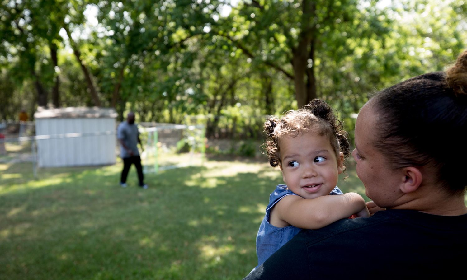 Marc Wilson and his daughter India play with his granddaughter. Part of the One Crisis Away: Price of Prison series.