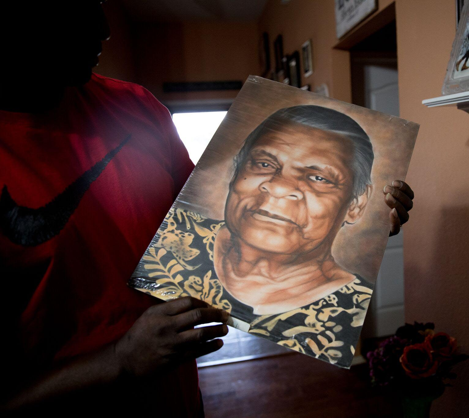 A fellow inmate gave Ed a painting of his grandmother, Maggie Dews. She died while Ed was in prison. / Photo: Allison V. Smith for KERA
