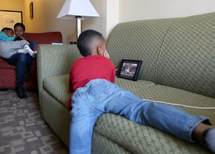 Jordan, 4, watching TV on an iPad. Photo/Thorne Anderson