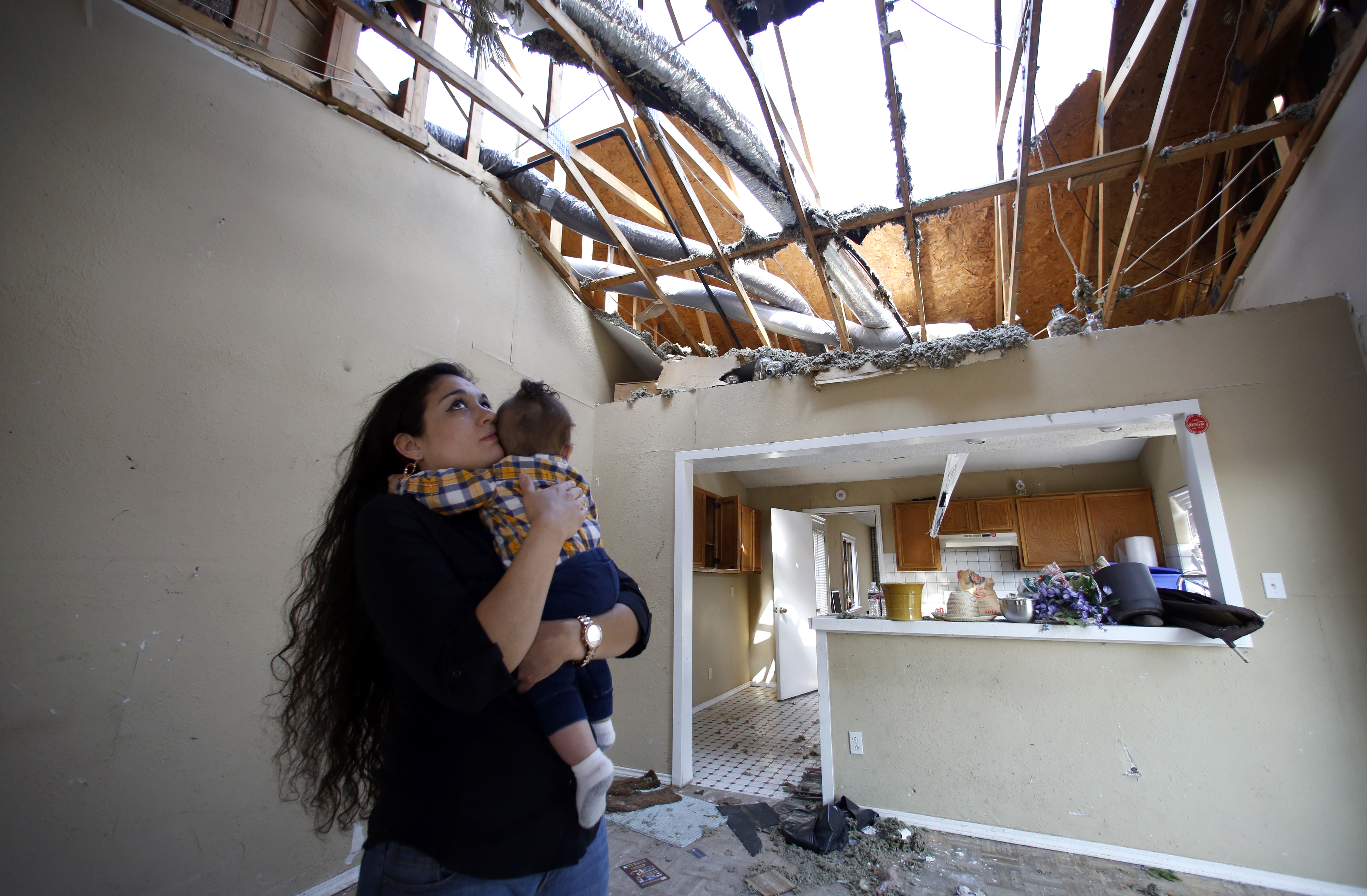 Lindsay Diaz and her son, 7-month-old Arian Krasniqui, in the livingroom of their Rowlett home where they hunkered down in the bathtub for safety during the December tornadoes. They have bounced around from family homes to hotels waiting on a temporary rent house to open up. Photographed Friday, February 19, 2016. Photo/Lara Solt