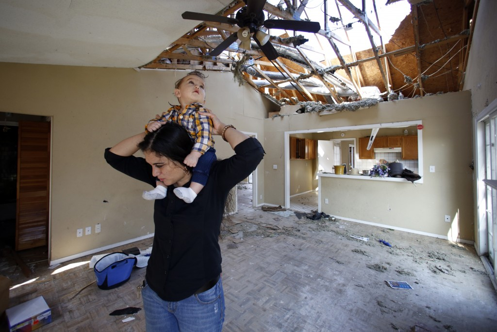 Lindsay Diaz and her son, 7-month-old Arian Krasniqui, in the living room of their Rowlett home. Photographed Friday, February 19, 2016. Photo/Lara Solt