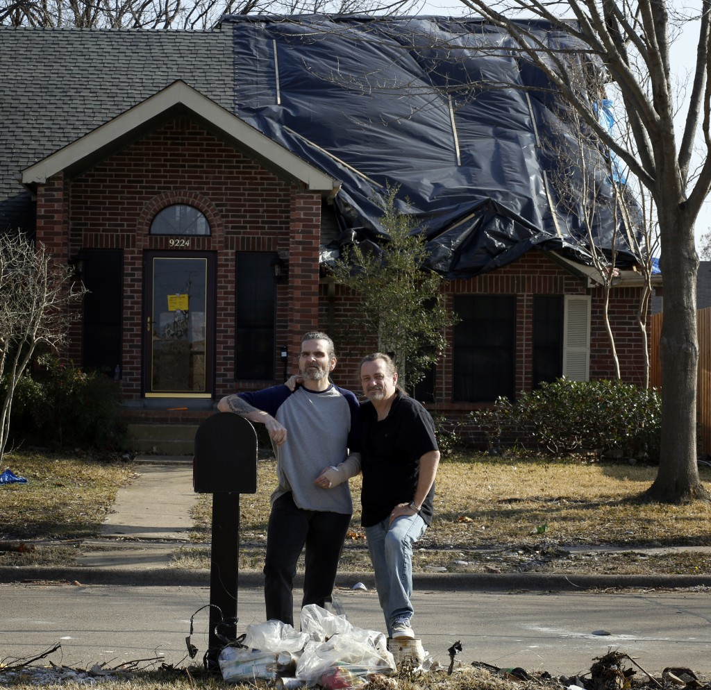 The home of Alfredo (left) and Anthony Fowler-Rainone, of Rowlett, was seriously damaged in the December tornadoes. They are currently rebuilding their house and their lives. Part of the roof is missing, ceilings are caved in, a wall is missingÉ it might be a total loss. The couple, who have been together for 10 years and were legally married in New York, are both HIV positive, on disability and on a fixed income. If they are able to rebuild, theyÕll at the very least be out $4,000 because they are under-insured due to rising home values. TheyÕll have to get a loan and cut every ounce of spending fat to make it work. TheyÕre currently in a pet friendly hotel with their three dogs. They were home when the tornado hit and say the experience was terrifying. Photographed Monday, February 1, 2016. (photo copyright Lara Solt)