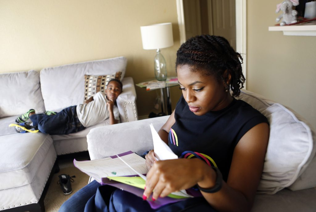 Jennifer Anderson and her son Jordan Anderson, 5, go over his homework at their rented home they share with a roommate in Garland. Their apartment was destroyed in a tornado in December 2015. Photographed on Monday, November 15, 2016. (photo © Lara Solt)