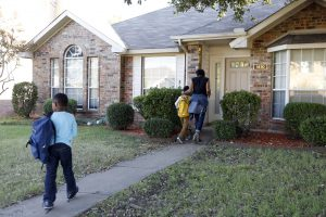 Jennifer Anderson and her sons Jayden Anderson, 6, (right) and Jordan Anderson, 5, (left) come home after school to their rented home they share with a roommate in Garland. Their apartment was destroyed in a tornado in December 2015. Photographed on Monday, November 15, 2016. (photo © Lara Solt)
