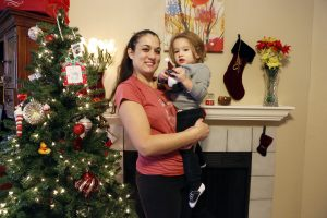 Lindsay Diaz and her 1.5 year old Arian at the home she is currently renting until her new home is built in Rowlett. Her duplex was mistakenly torn down after a tornado severely damaged it in December 2015. Photographed on Friday, December 9, 2016. (photo © Lara Solt)